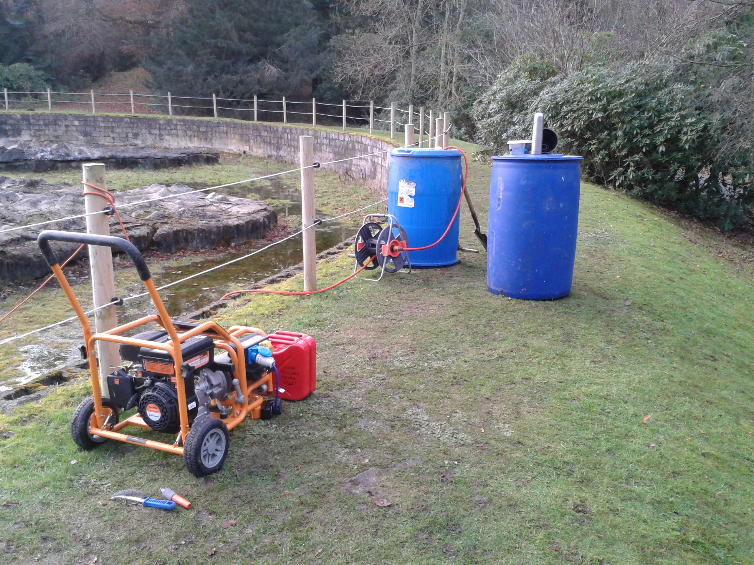 Shows a generator used to pump water for pressure blasting moss on the surface of The Great Polish Map of Scotland