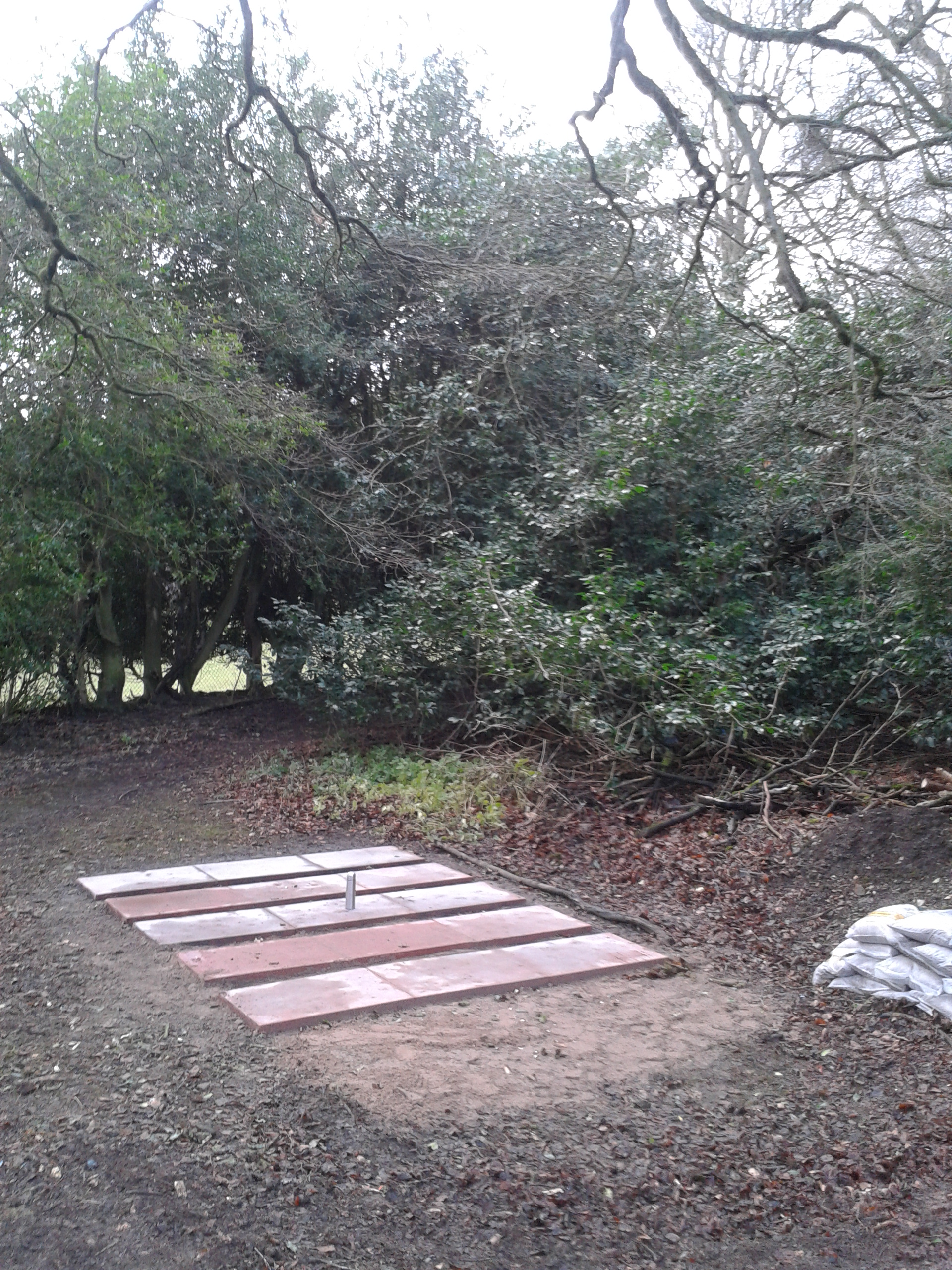 Paving slabs in place on the site for a new workshop next to the map