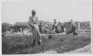 Old photograph showing Jan Tomasik supervising work on a building site in prewar Poland
