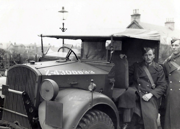 Jan Tomasik and another soldier photographed beside an Army truck at Carnoustie in December 1940